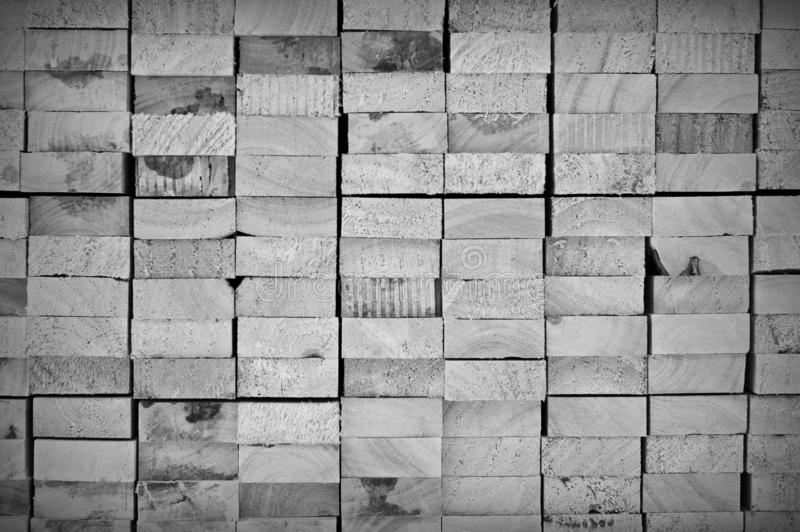 Cross section of arranged timber brown wood for backgrounds black and white with vignette royalty free stock photography