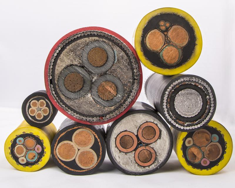 Cross section of low-voltage cable. Cross section of high-voltage cable. Thick copper veins are surrounded by a thick layer of polymer insulation steel tape stock images
