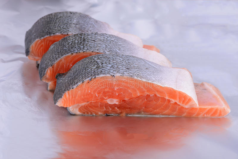 Cross section of a salmon. A cross section of a salmon on a foil stock image