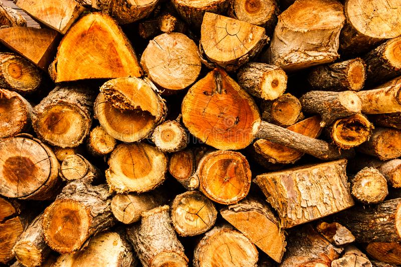 Cross sectional wooden log pile background, construction material or interior concept royalty free stock photo