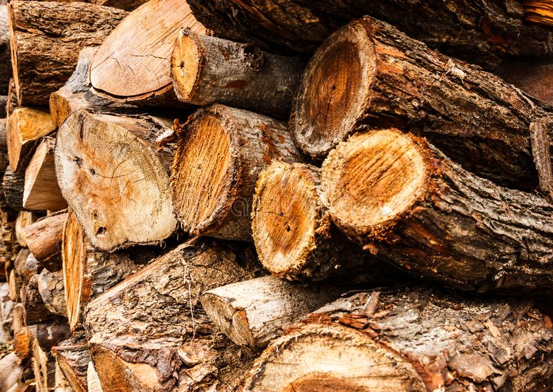 Cross sectional wooden log pile background, construction material or interior concept. royalty free stock photos