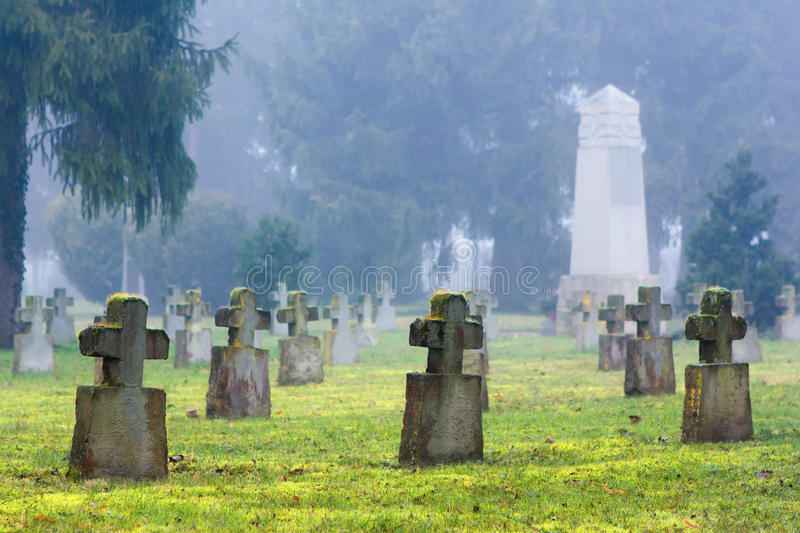 Cross-shaped tombstones in an old cemetery stock images