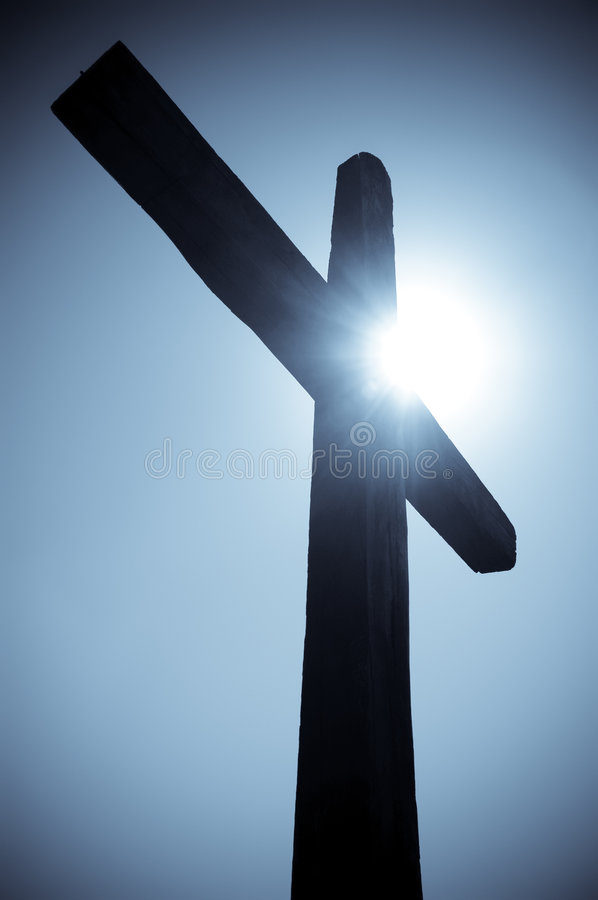Cross silhouete. Silhouette of the Christian cross against the sun royalty free stock image
