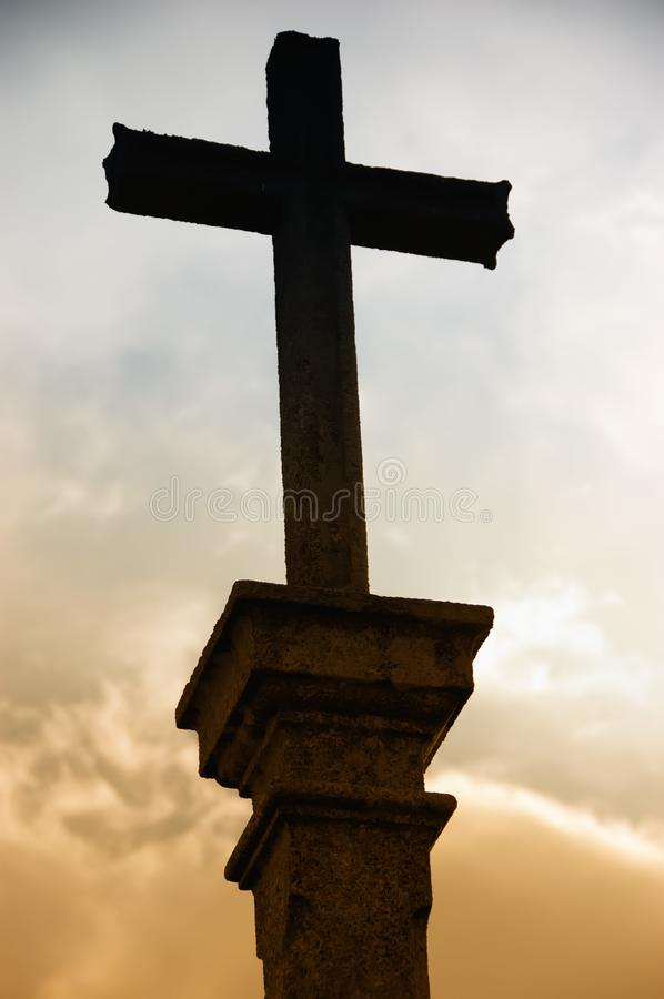 Cross silhouette and the cloud stock photos