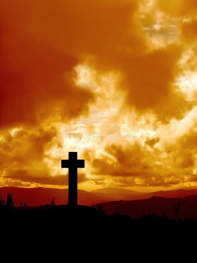 Cross silhouette in high mountain stock photo