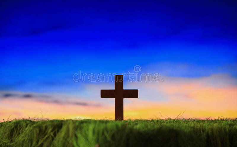 Cross silhouette with sunset background stock photography