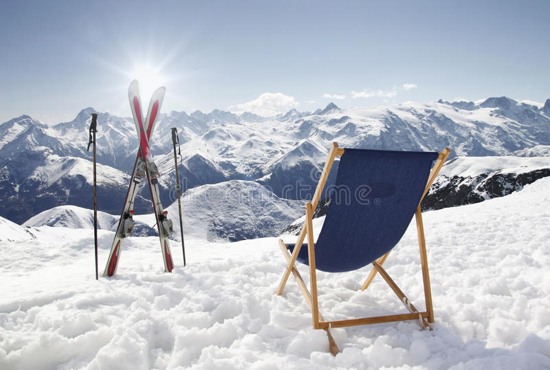 Download Cross Ski And Empty Sun-lounger At Mountains In Winter Stock Image - Image: 29704815
