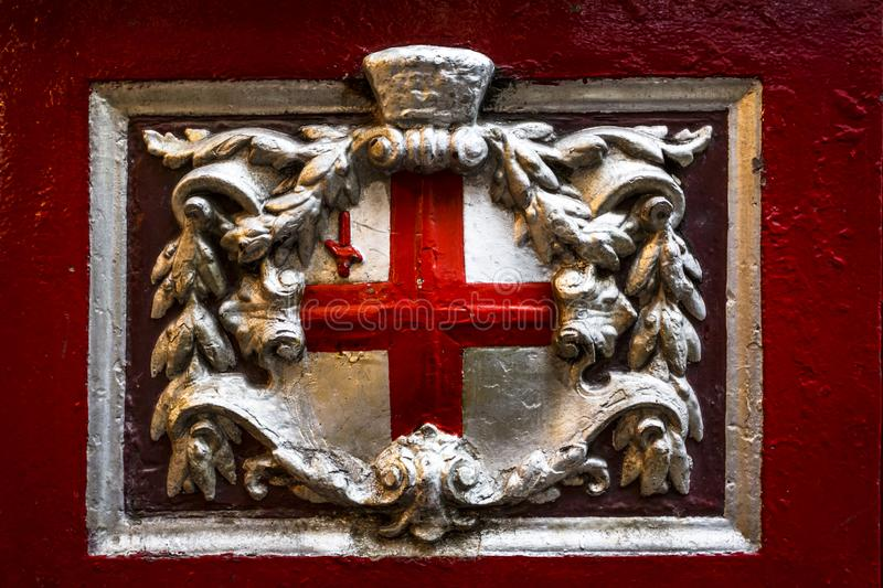 The Cross of St George inside of Leadenhall Market, The City, London, England, United Kingdom, Europe stock images