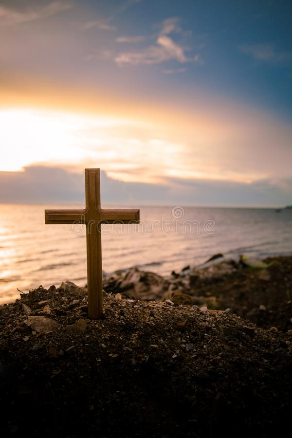 the cross standing on meadow sunset and flare background cross on a hill as the morning sun comes up for the day stock photo image of hill forgive 119728066 the cross standing on meadow sunset and