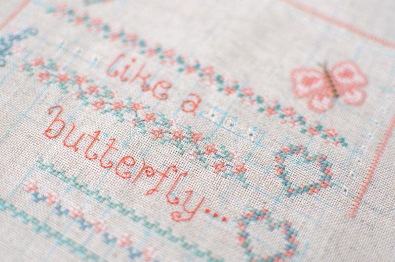 Cross Stitch Embroidery On Linen Sampler With Floral Patterns