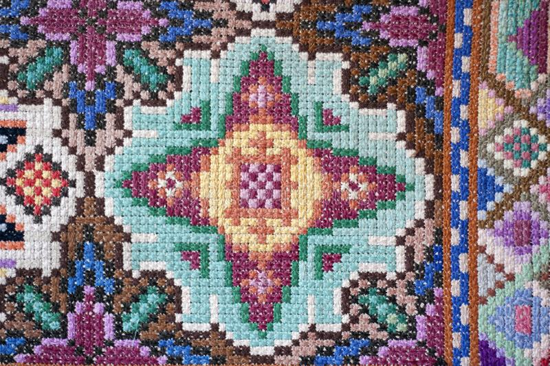 Cross stitched beautiful handmade carpet. Traditional national embroidery royalty free stock photos