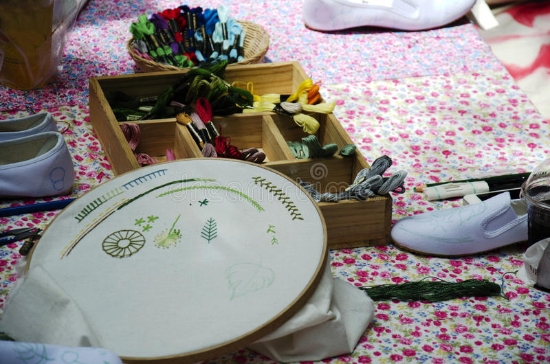 Cross Stitching on cotton fabric at my workshop stock photos