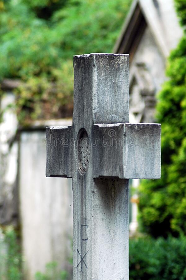 Cross stone in a cemetry stock image