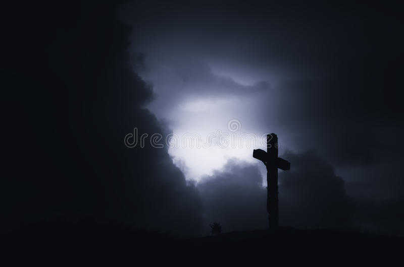Cross on stormy sky royalty free stock image