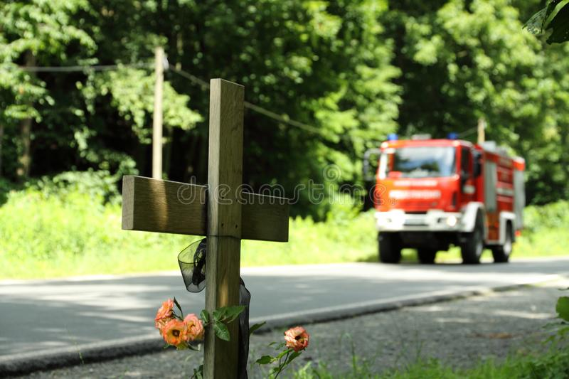 Cross on the street. After deathly accident stock photos
