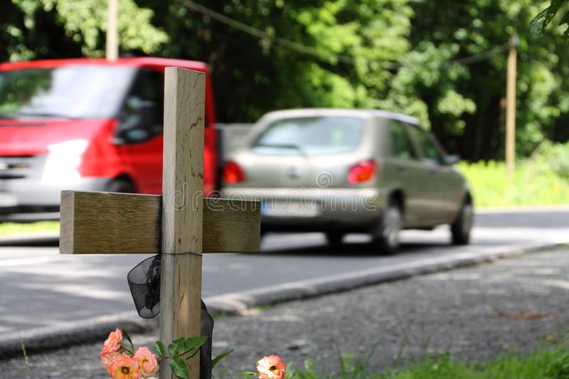 Cross on the street. After deathly accident stock photo
