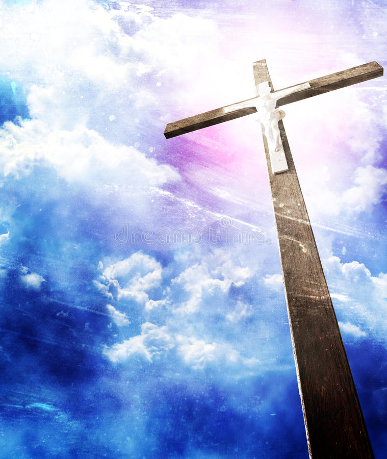 Cross in sun rays. Against cloudy sky stock image