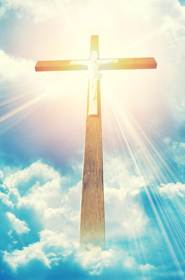 Cross in sunrays stock images