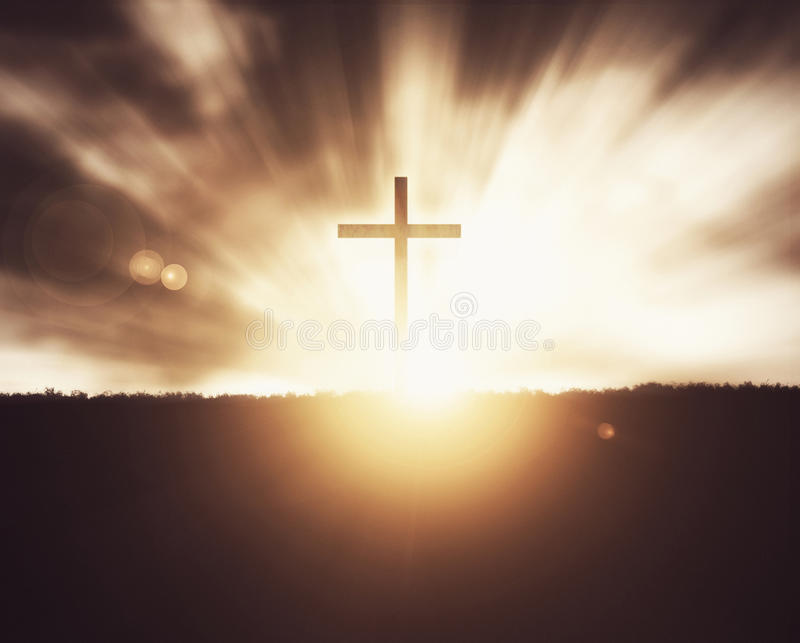 Cross at sunset. Christian cross at sunset on grass field background royalty free stock photography