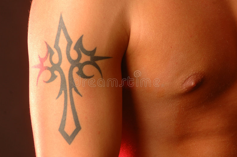 Cross tattoo stock photo