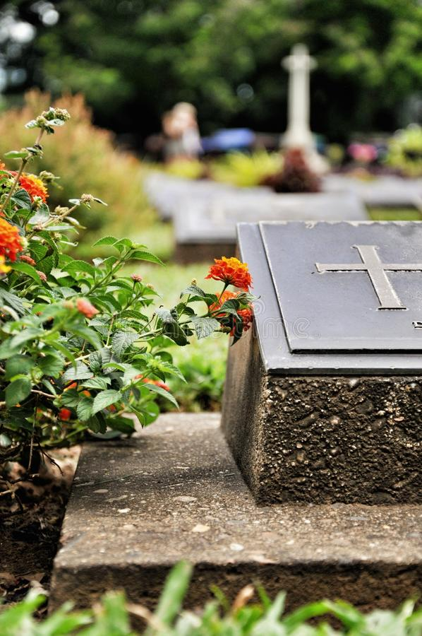 Cross on tombstone in cemetery. Engraving with christian religious symbol royalty free stock images