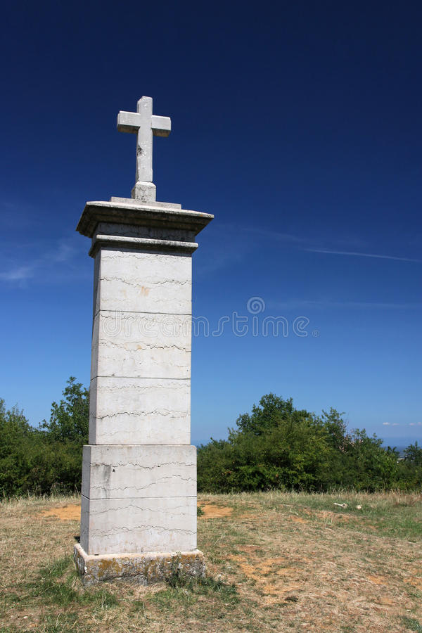 Cross At The Top Of The Hill Royalty Free Stock Image