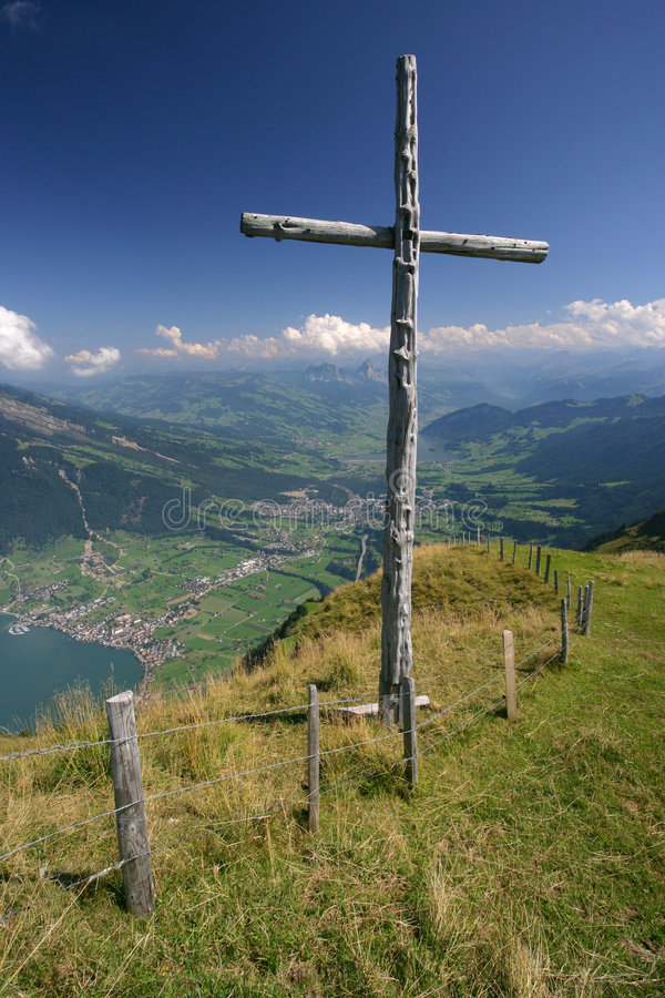 Cross on top of mountain stock images