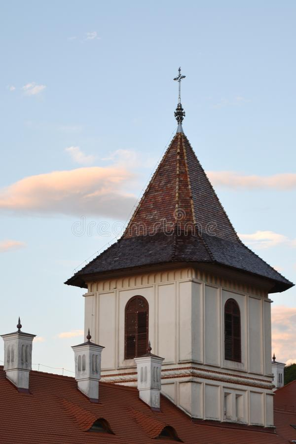 Cross tower of orthodox Brancoveanu Monastery and Church royalty free stock photography
