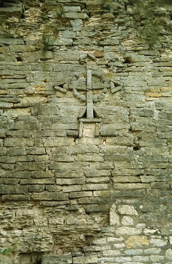 Cross on the wall royalty free stock photos