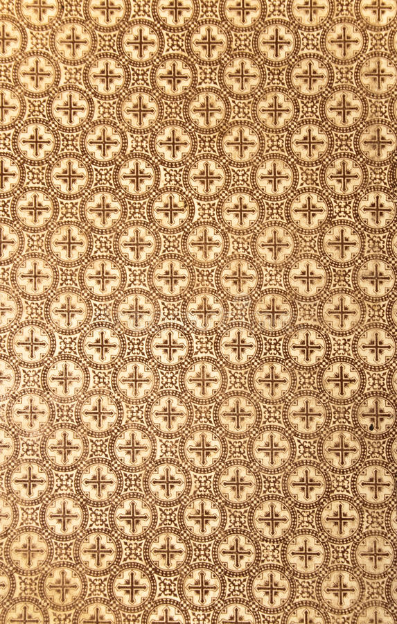 Cross wallpaper. A photo of a brown wallpaper with crosses on it royalty free stock photos
