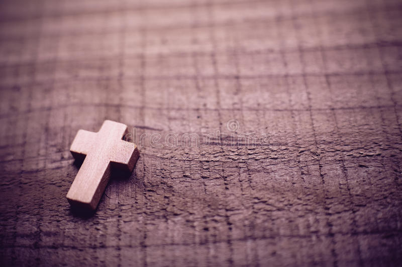 Cross On The Wooden Background royalty free stock photo