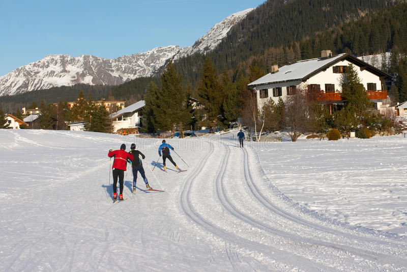 Crosscountry skiers on a track in Davos. Switzerland stock photography