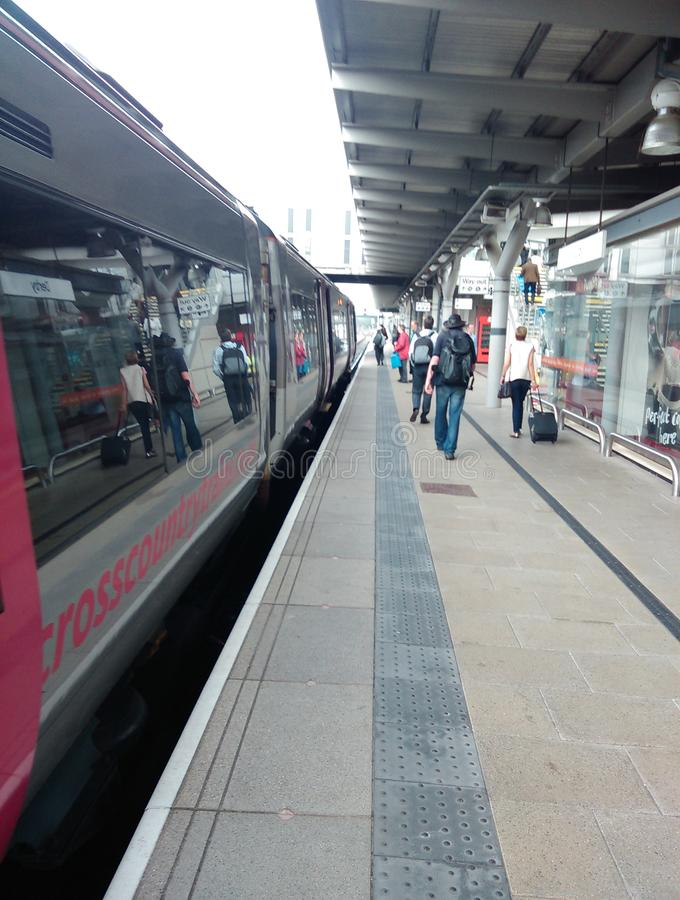 Crosscountry train in derby railway station. Diesel passenger rail stops in derby with passengers on the platform royalty free stock photo
