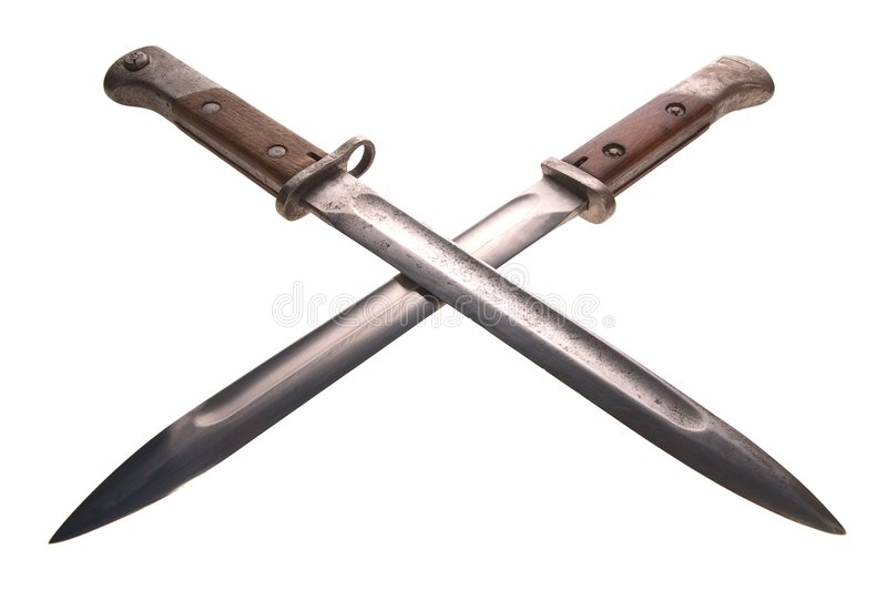 Crossed bayonets. Two old bayonets crossed on white background royalty free stock images