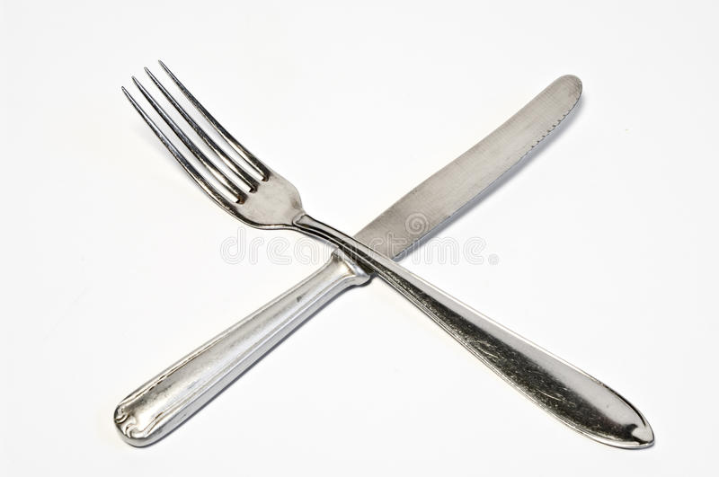Crossed fork and knife royalty free stock image