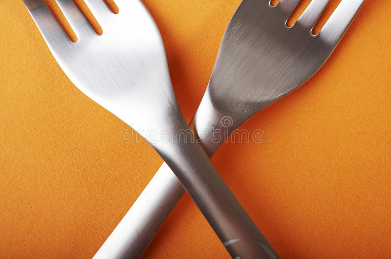 Crossed forks royalty free stock image