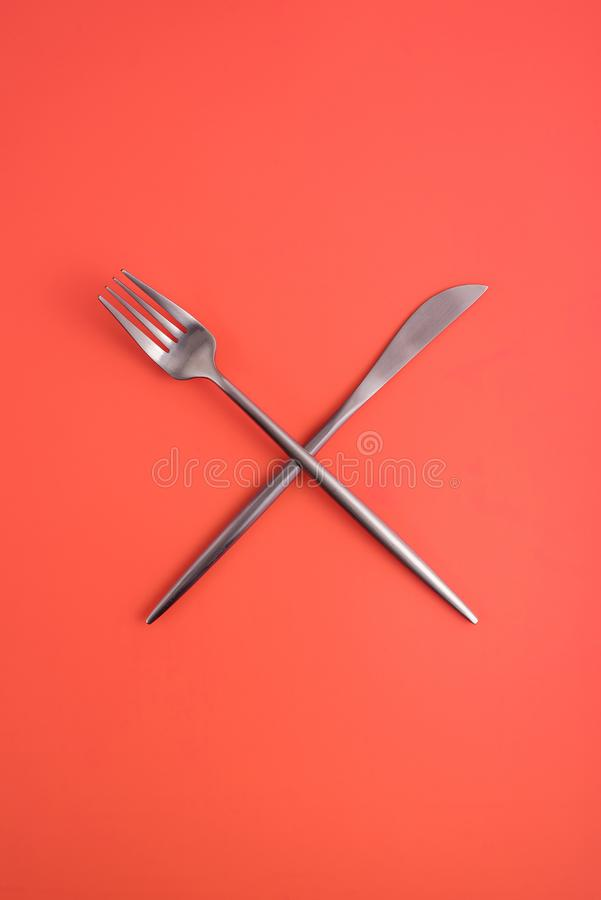 Crossed forks and a knife. stock photos