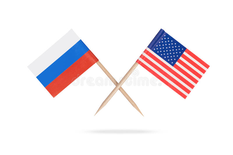 Crossed mini flags USA and Russia royalty free stock images