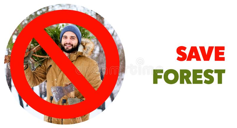 Crossed out red sign on bearded lumberjack man carrying freshly cut down christmas fir tree and axe in woods. Save stock photography