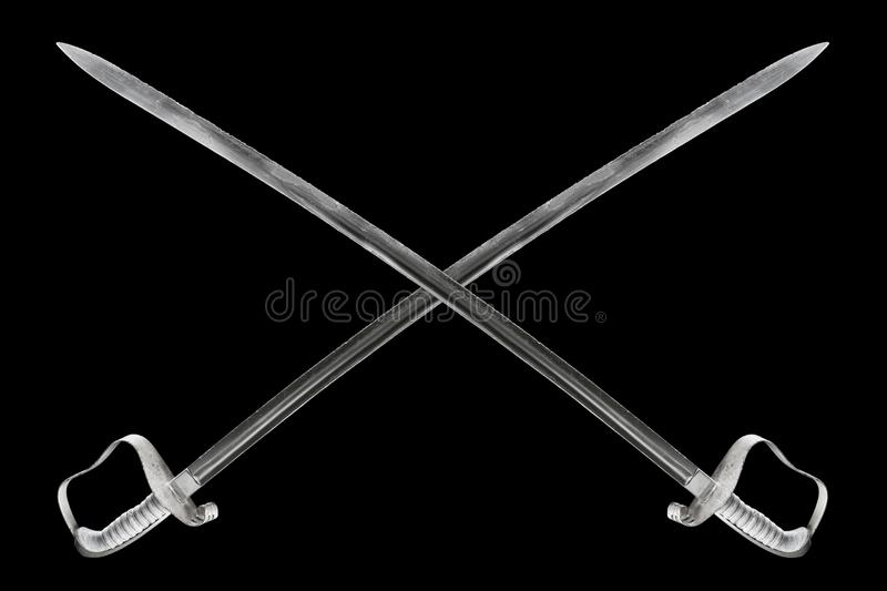 Crossed saber. Clipped pirate saber on black isolated background beautiful light royalty free stock photos