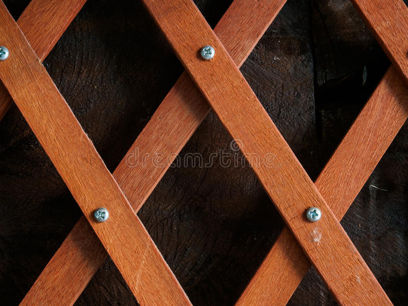 Crossed wood lath. Wood slat fence beside the cottage stock photography