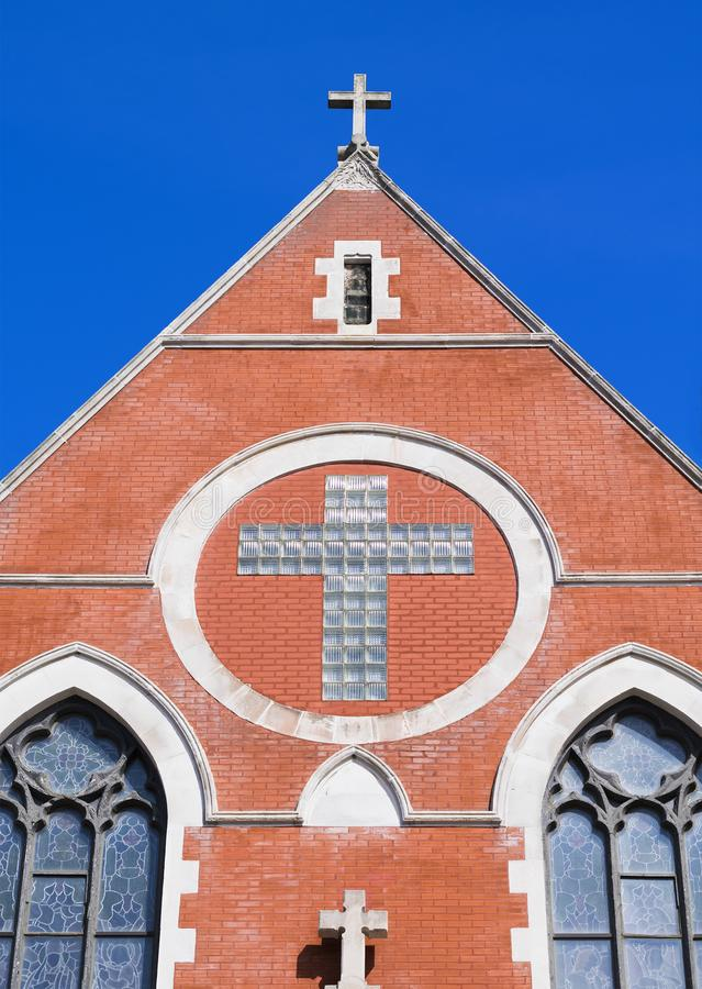 Crosses on a Church. A brick church against a blue sky royalty free stock image