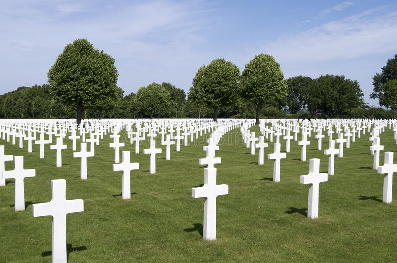 Crosses on military graves of fallen U.S. soldiers at the Netherlands American Cemetery and Memorial. stock photo