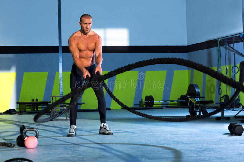 Crossfit battling ropes at gym workout exercise stock image