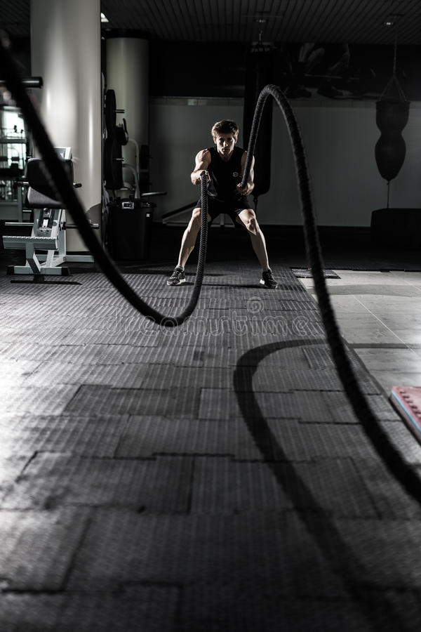 Crossfit battling ropes at gym workout exercise. Crossfit stock image