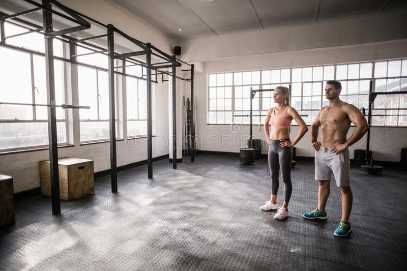 Crossfit couple posing with hands on hips stock image