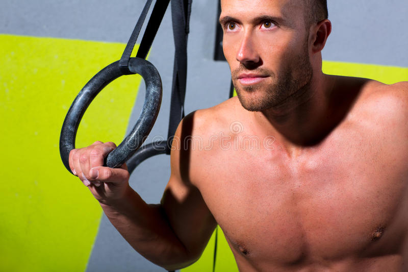 Crossfit dip ring man relaxed after workout at gym dipping royalty free stock photo