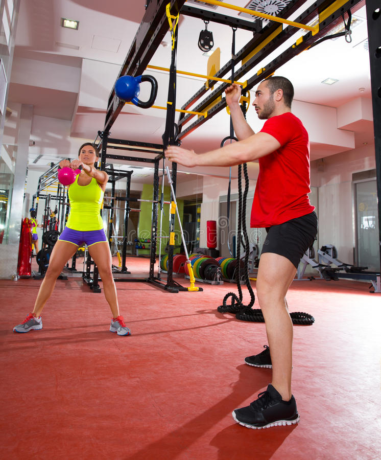 Exercise Kettlebell Figure Eight: Crossfit Fitness Kettlebells Swing Exercise Workout At Gym