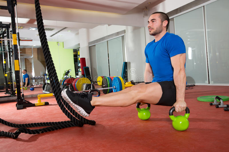 Crossfit Fitness Man L-sits Kettlebells L Sits Exercise Stock Image