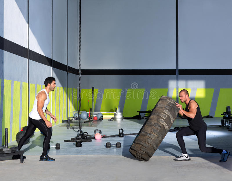 Crossfit Flip Tires Men Flipping Each Other Stock Photography